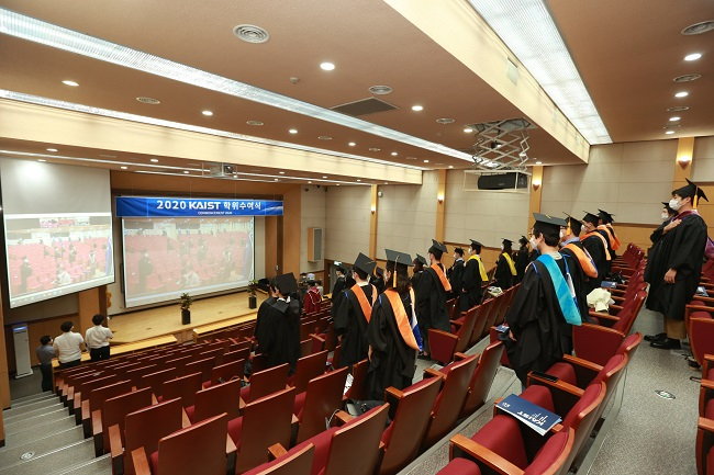 Graduates were divided into three groups to attend at three different places and watched the ceremony via Zoom.